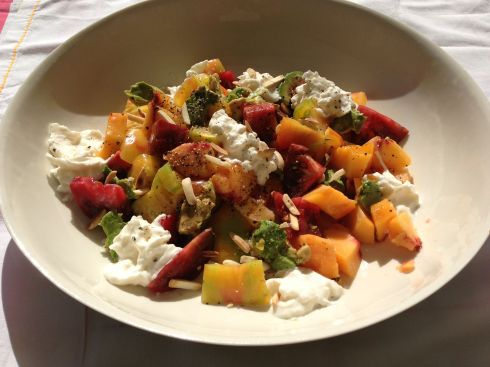 This is my favorite summertime salad. It all comes together whenever I can get the fresh ingredients all in place. The peaches are the key !