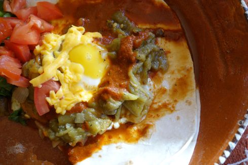 "When I visit home the first thing I do after a big family hug is head for the closest  New Mexican resturant to feed my chile jones. Huevos Rancheros with ""Christmas"" Chile, a combo of both red and green is always my first choice. Here is my best shot at my favorite southwestern breakfast dish."