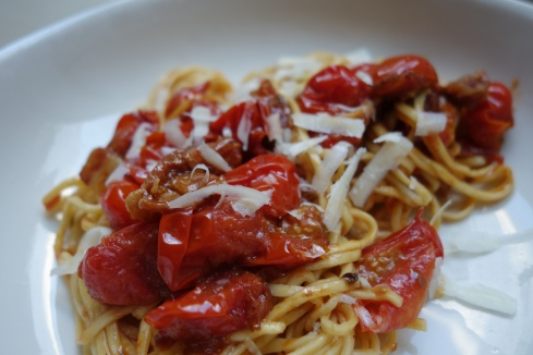 This is my all time favorite pasta dish. Its simple and rustic. The flavors are deep and savory. I tweeked the recipe a bit by using fresh Thai chiles and by using cherry tomatoes. They add a lovely sweetness to the sauce.